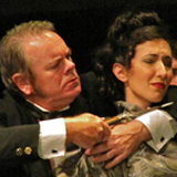 Moriarity threatening Irene Adler in the Naples Players production of Sherlock Holmes: The Final Adventure